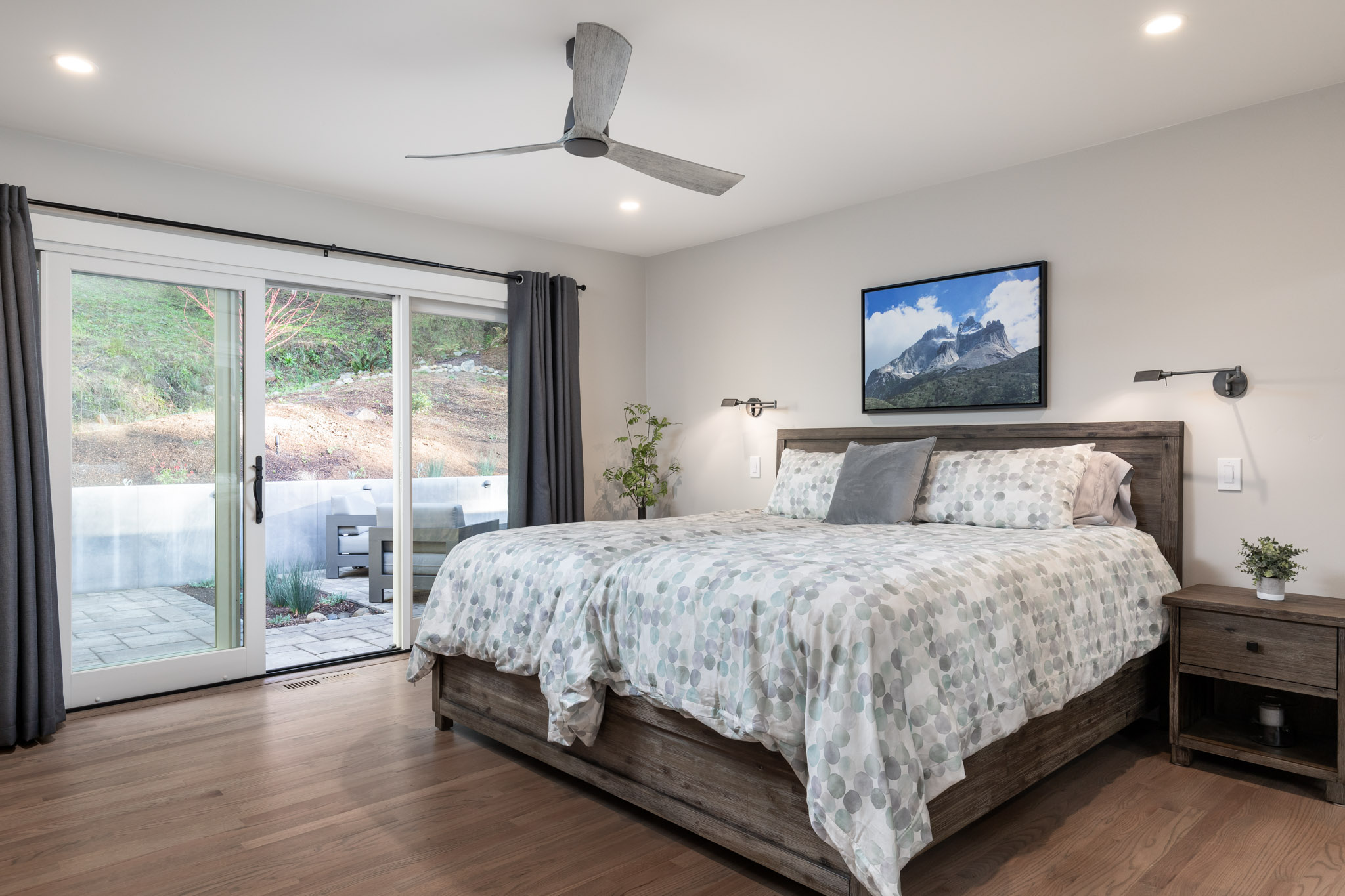 Bedroom with hard wood floors and brightly colored finishes