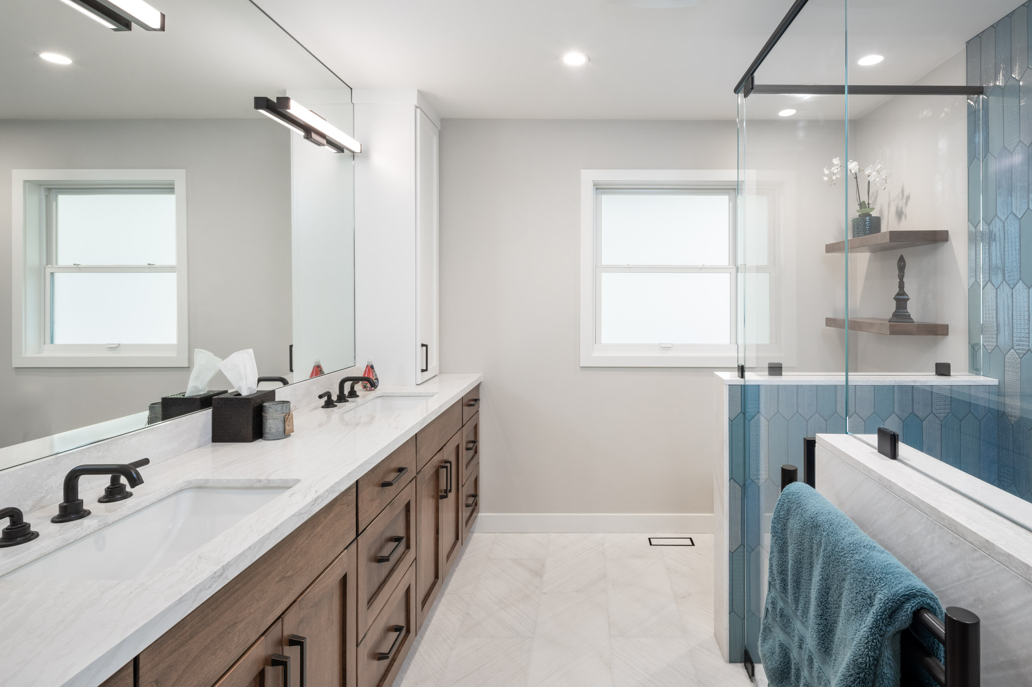 Bathroom with white and blue contrast creates open space
