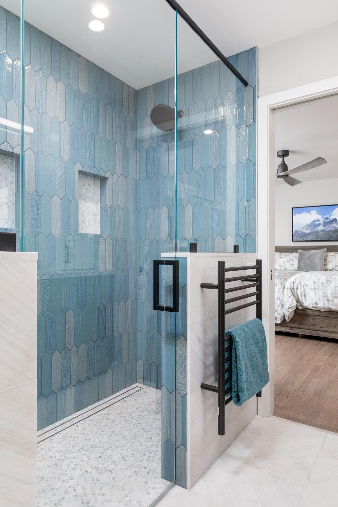 Blue tile shower with sliding glass door