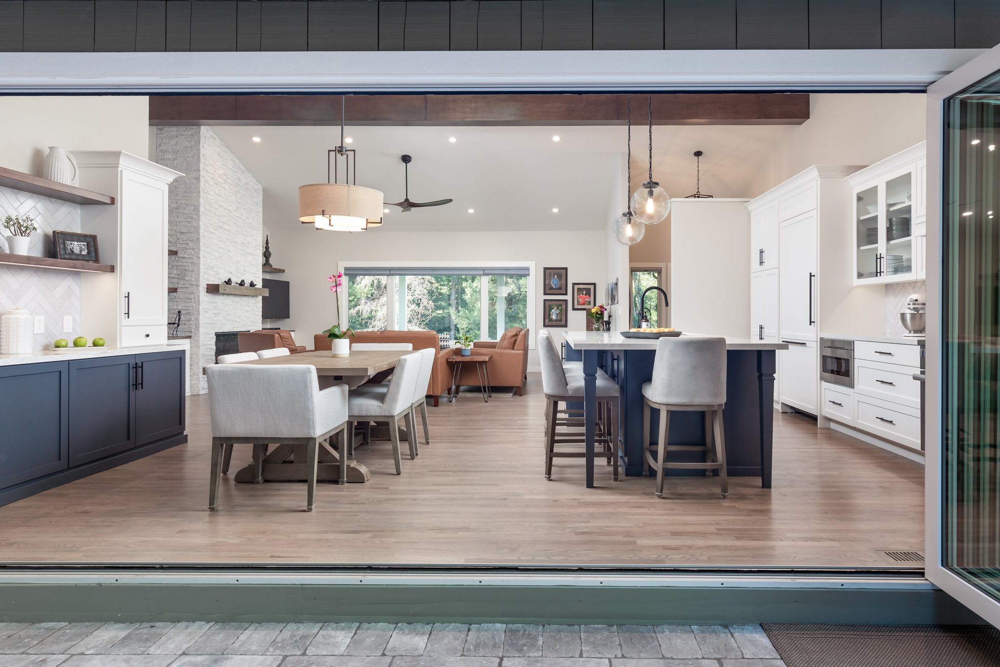 Kitchen and dining area seen through large window