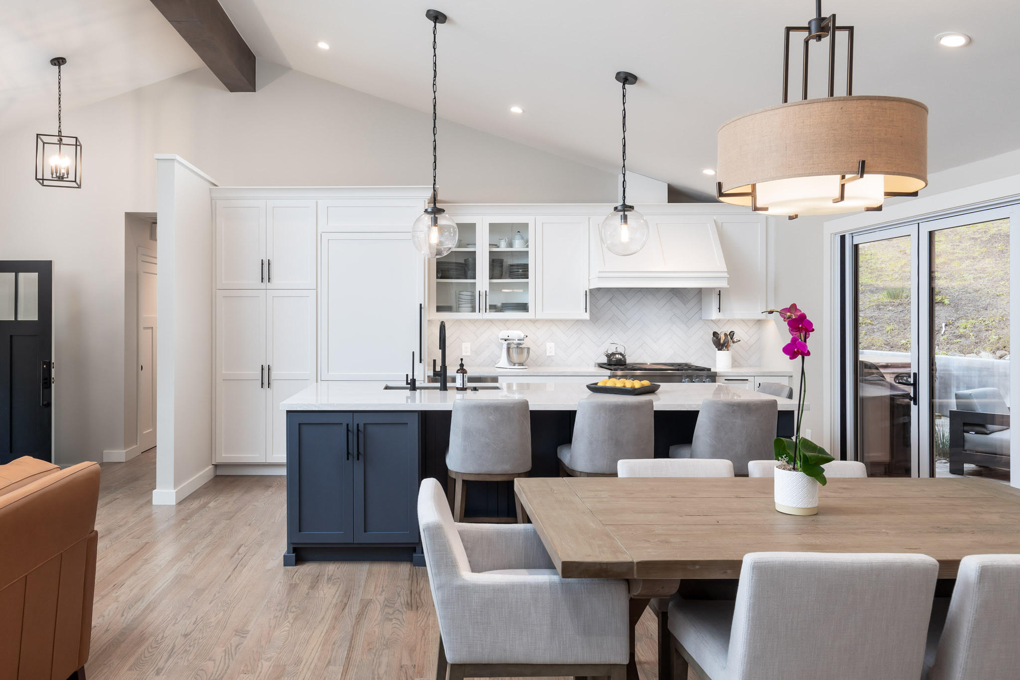 Kitchen with dining room table with grey seats