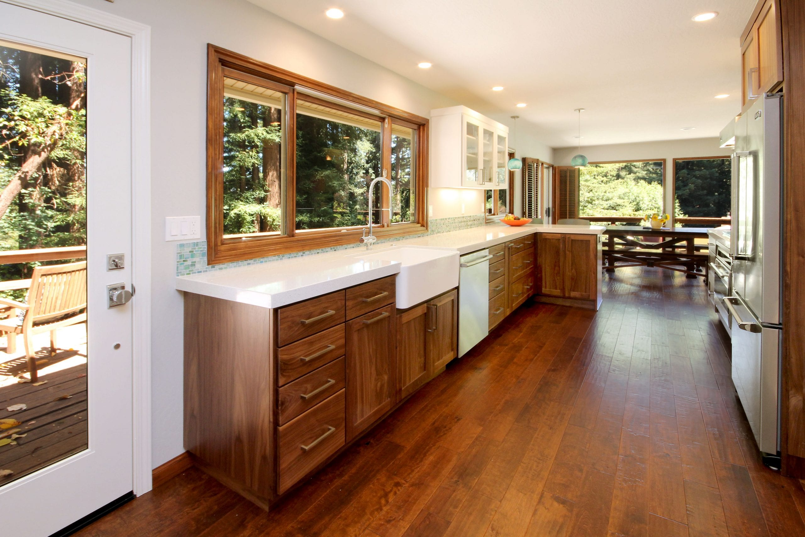 Kitchen remodel after with open footprint and hardwood flooring