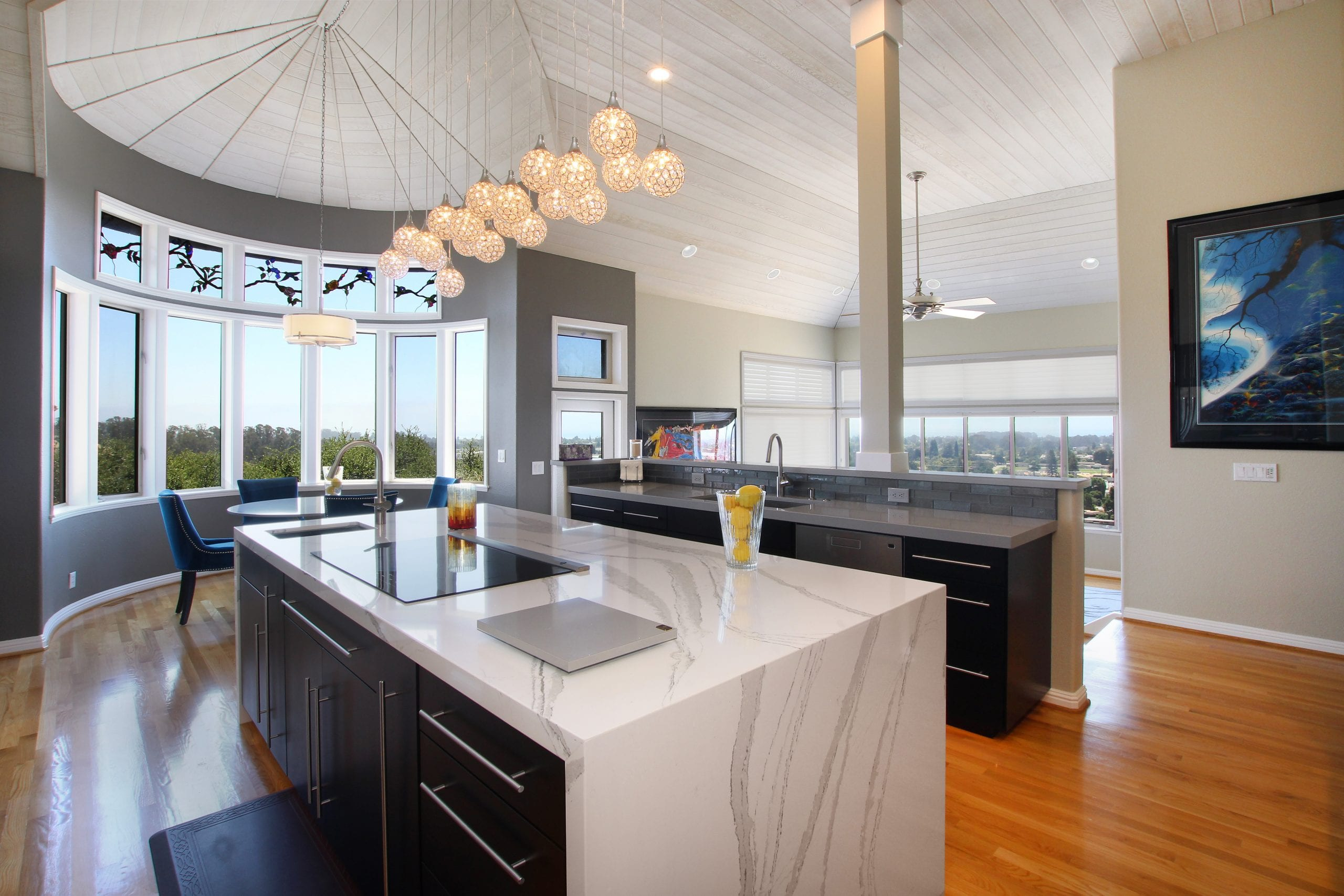 Kitchen with marble countertop, with grey granite streaks embedded