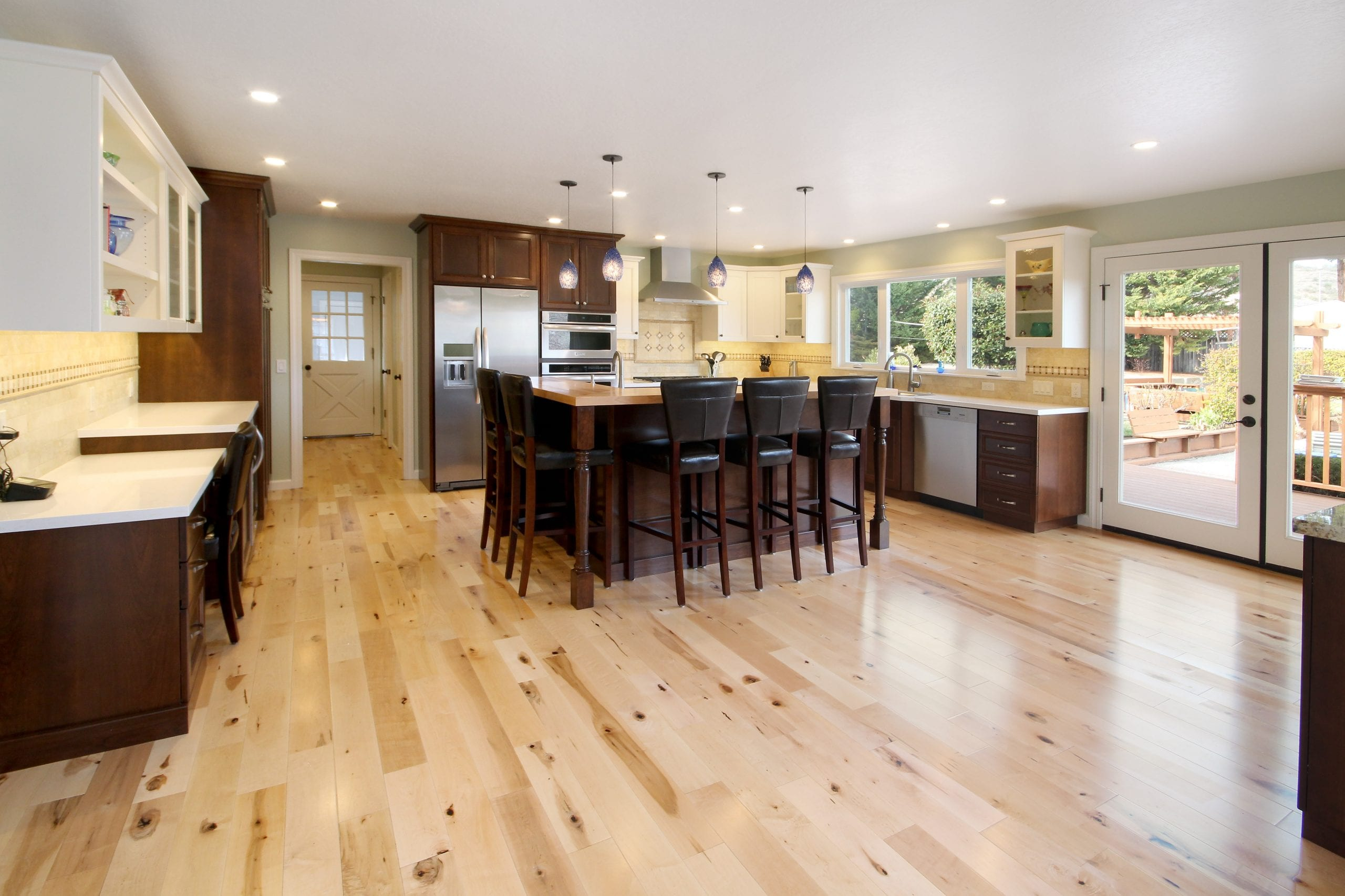 Kitchen remodel after photo featuring hardwood floors and modern style