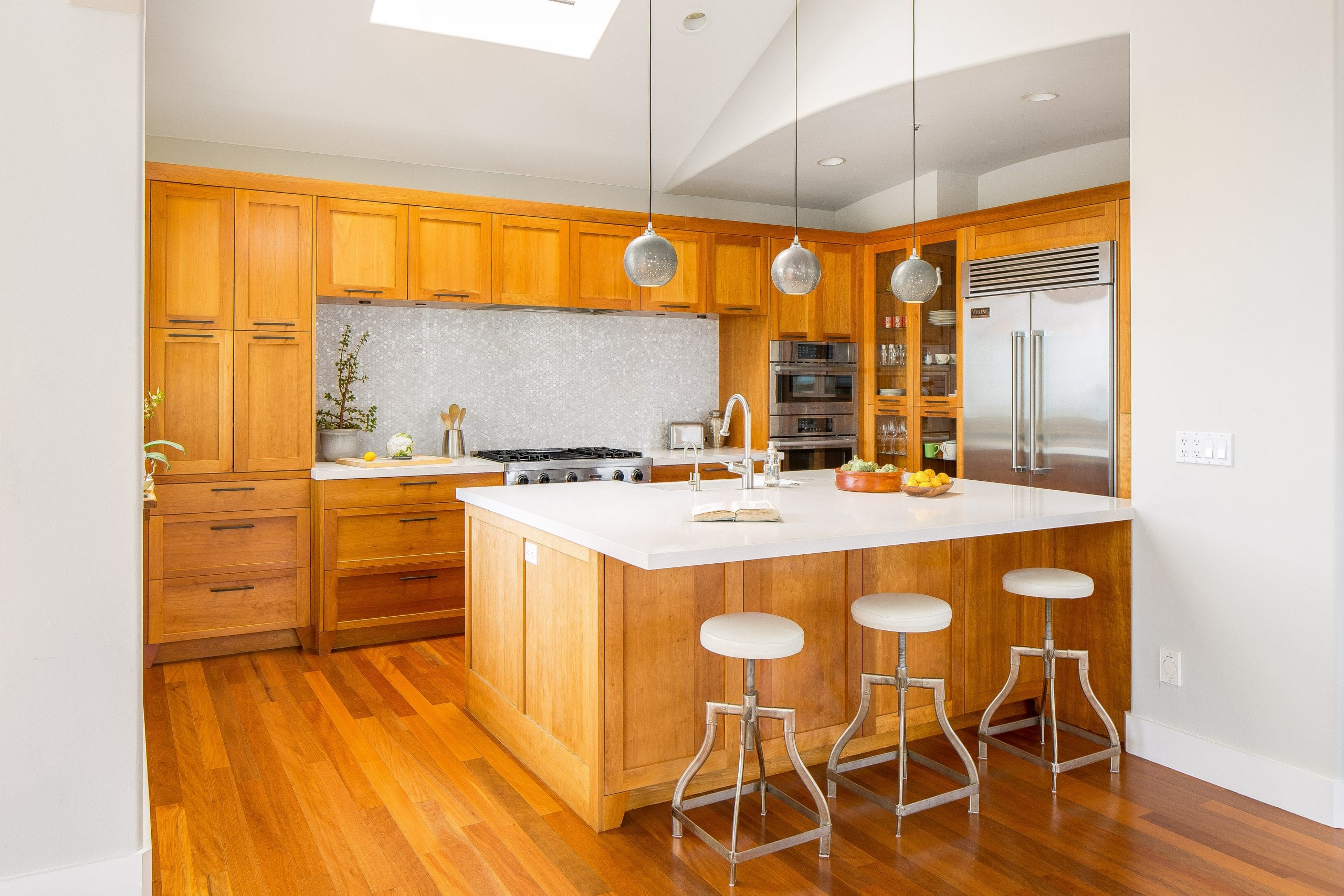 Kitchen remodel featuring matching hardwood cabinets and flooring