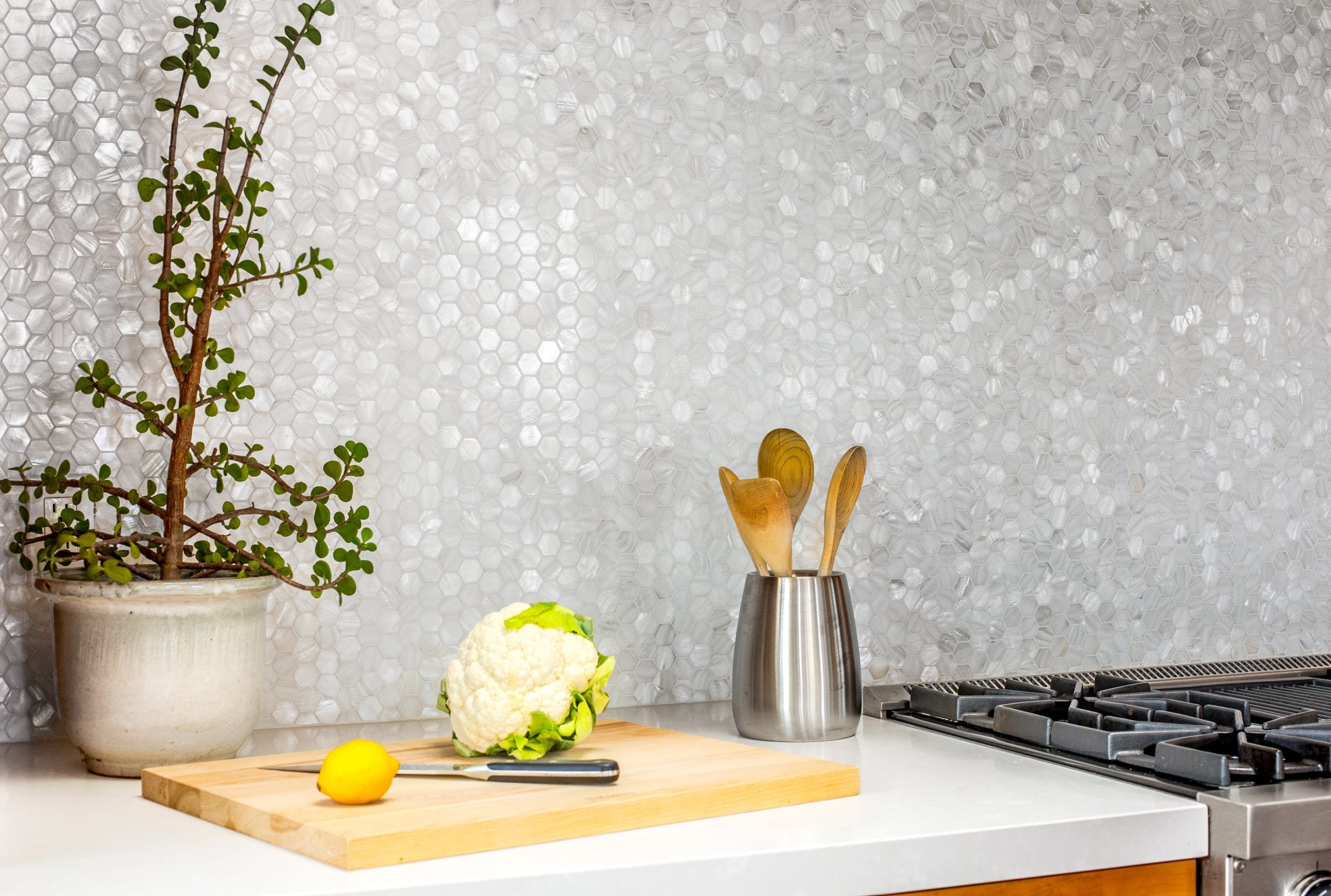 Hex-tile back splash over a kitchen countertop and stove