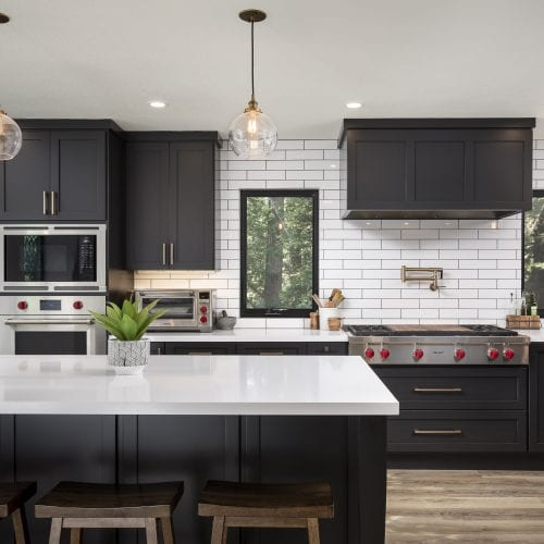 Black and white kitchen with tile backsplash