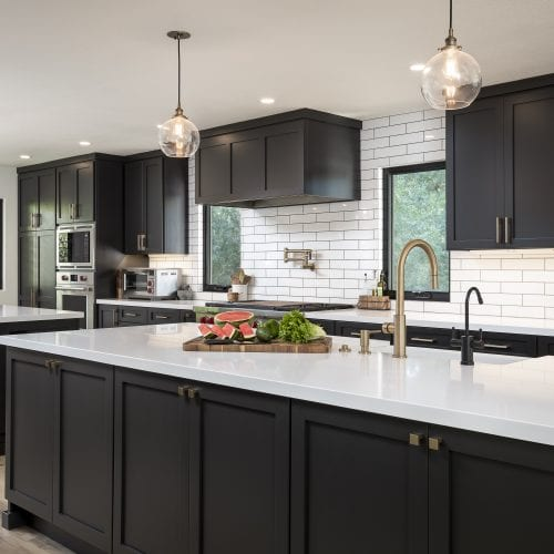 White tile backsplash with contrasting black fixtures
