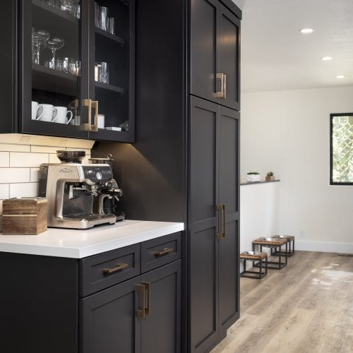 Black wooden storage cabinets with counter cut-out