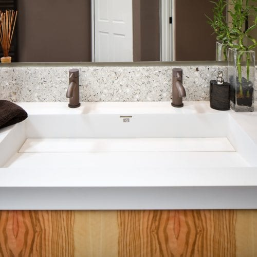 Square sink with two black faucets