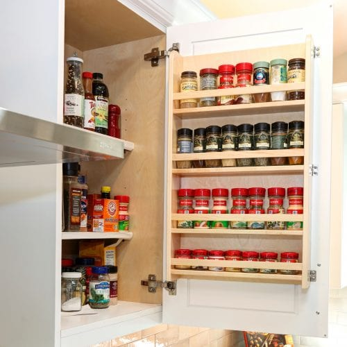 Kitchen cabinet with full spice rack and cooking essentials