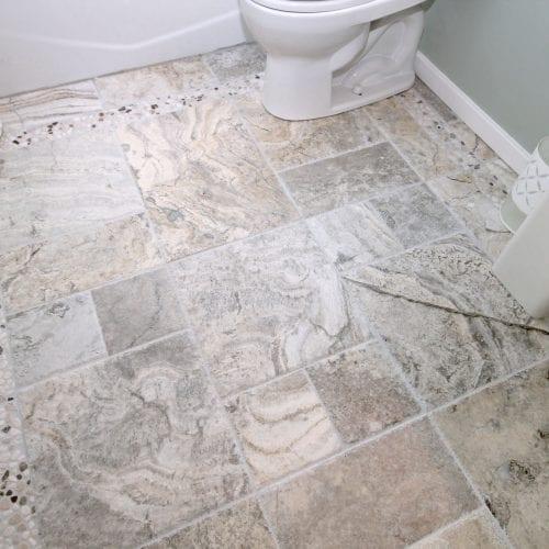 Multi-sized bathroom tile flooring