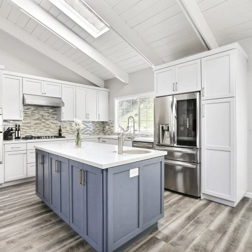 Kitchen with white cabinets and blue cabinets