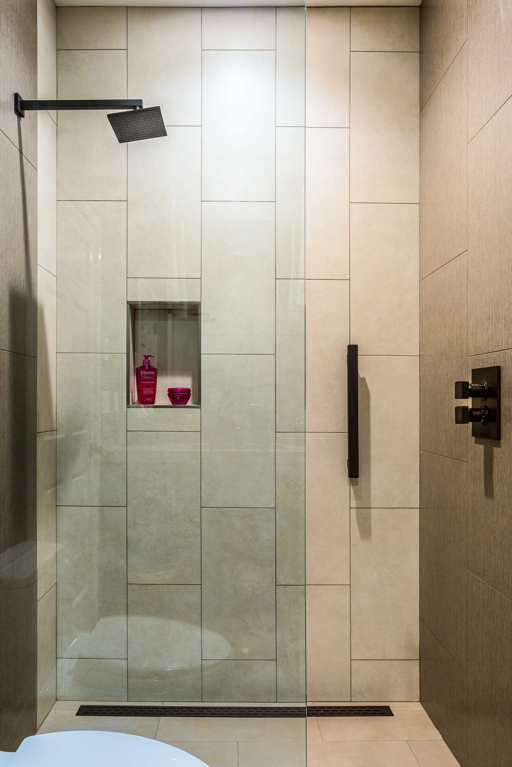 Shower with glass sliding door