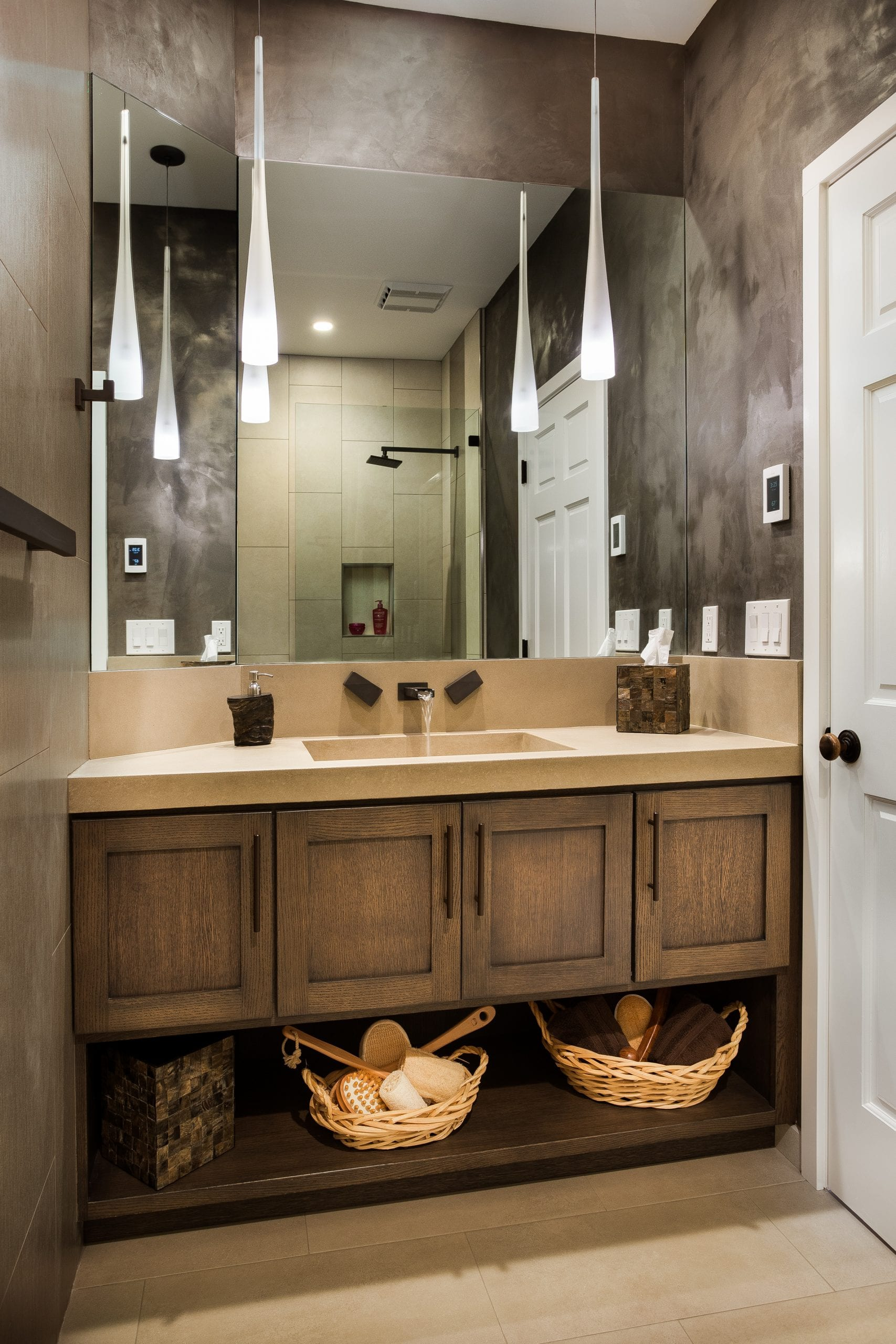Bathroom counter with baskets underneath for storage