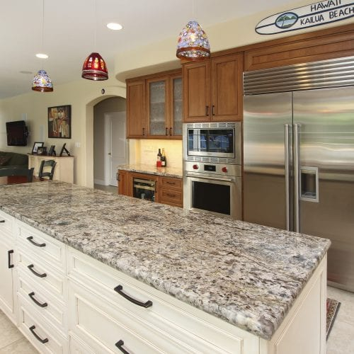 Granite countertop with hanging glass lamps above