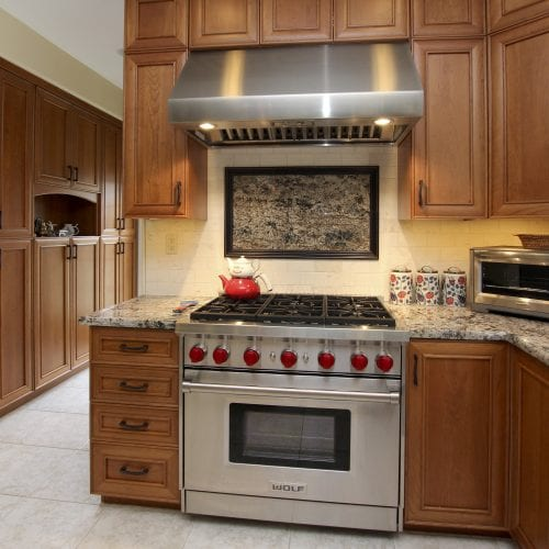 Stainless steel oven with accompanying exhaust hood
