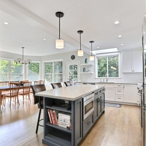 Kitchen island with three hanging lights above the countertop