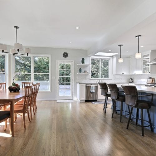 Kitchen with wide open wood flooring