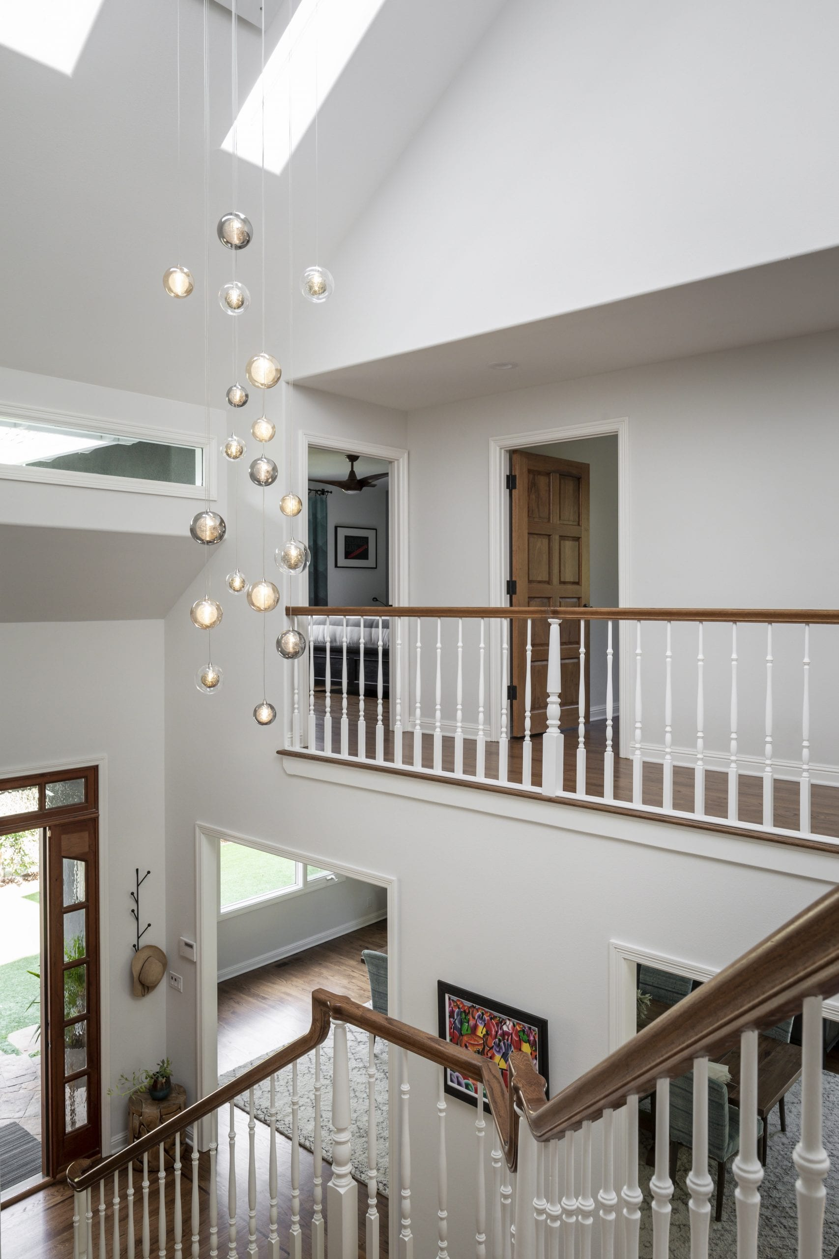 Upper level looking over front entrance with wood banister