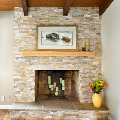 Limestone fireplace with wooden mantle