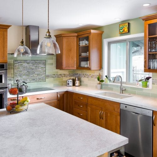 Wide angle shot of kitchen cabinets and cupboards