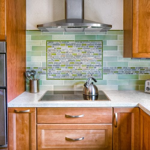 Green and Aqua tile backsplash above electric stove