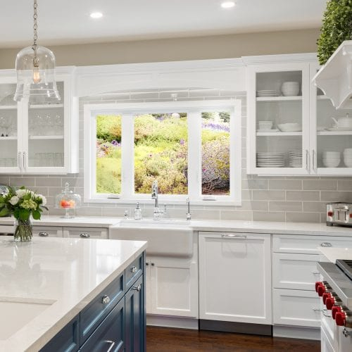 Kitchen with white wooden cabinets
