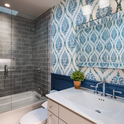 Bathroom with blue stenciling on the walls