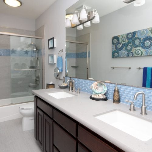 Light blue bathroom with stainless steel fixtures