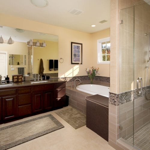 Bathroom with light tile floor and contrasting cabinets