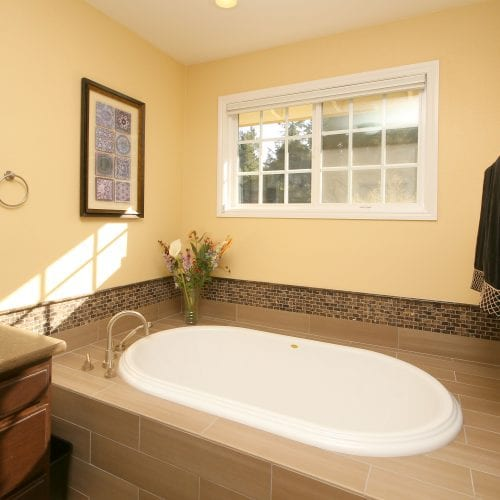 Bathroom tub with window above for natural light