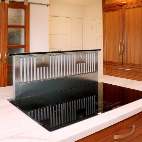 Electric stove with slated metal backsplash