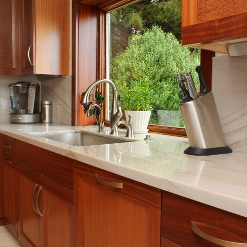 Kitchen counter with metal knife holder