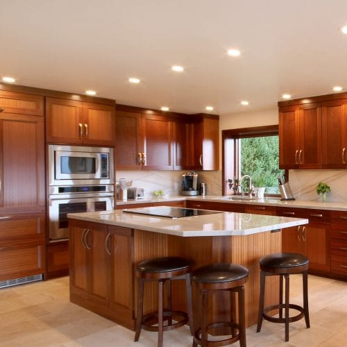 Kitchen island with red wood accent