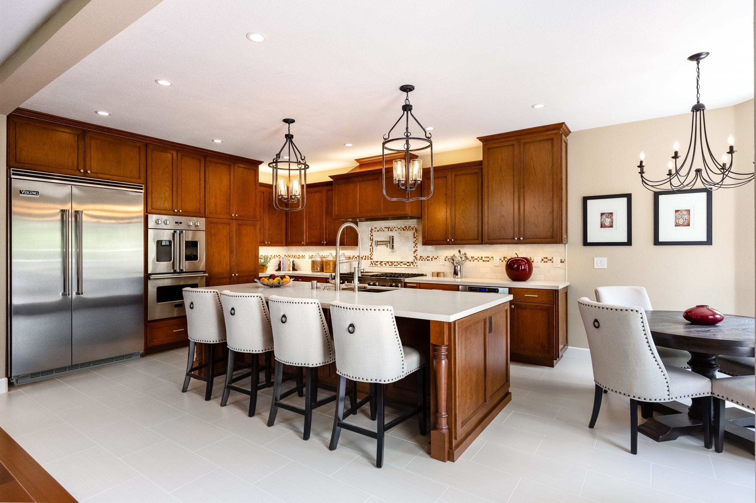 wide shot of kitchen showing full cabinet wall and kitchen island