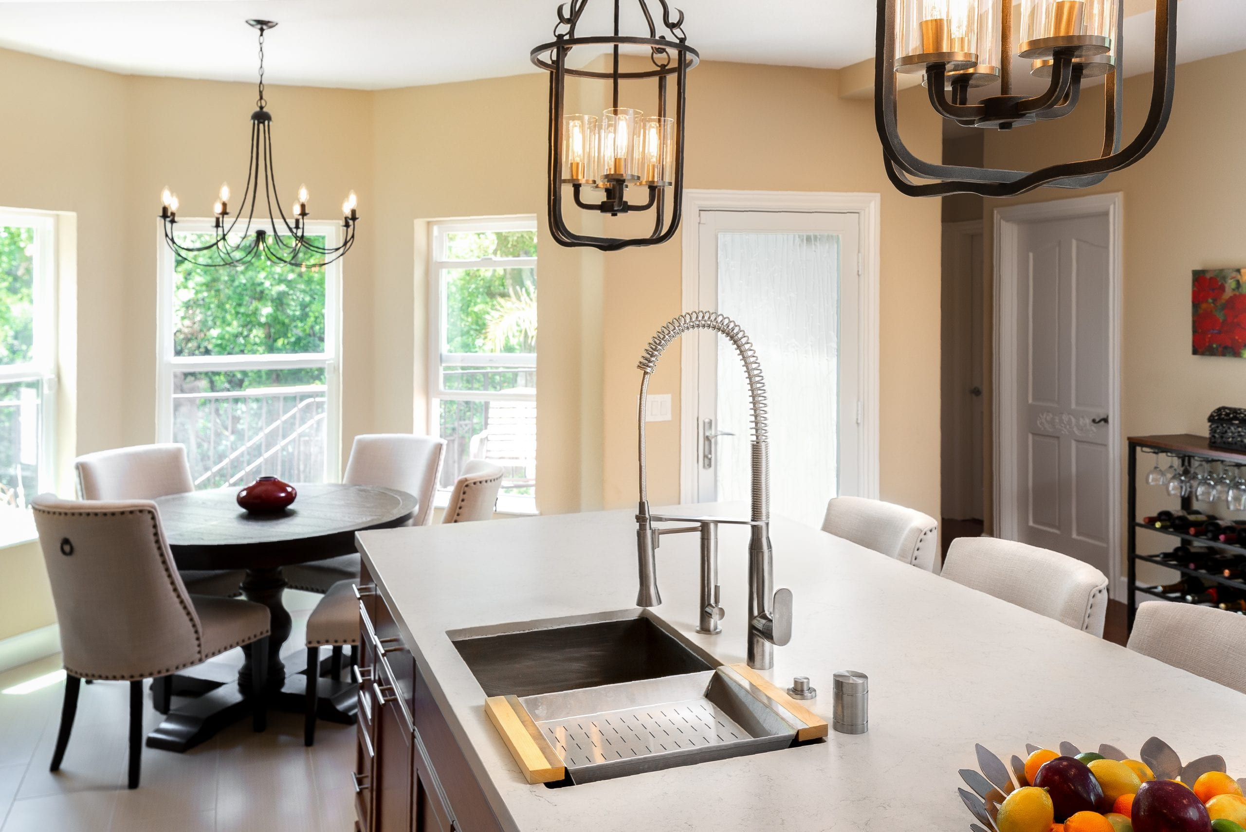 Stainless steel sink embedded into white marble countertop
