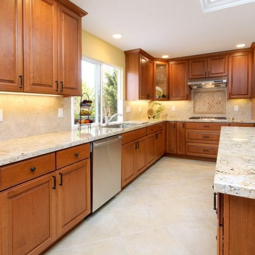 Kitchen remodel with wooden cabinets and a stainless steel dishwasher