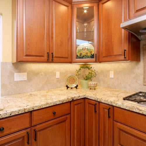 Kitchen corner with granite countertop and wood cabinets
