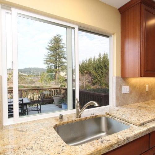 Kitchen sink with a half open sliding window pane