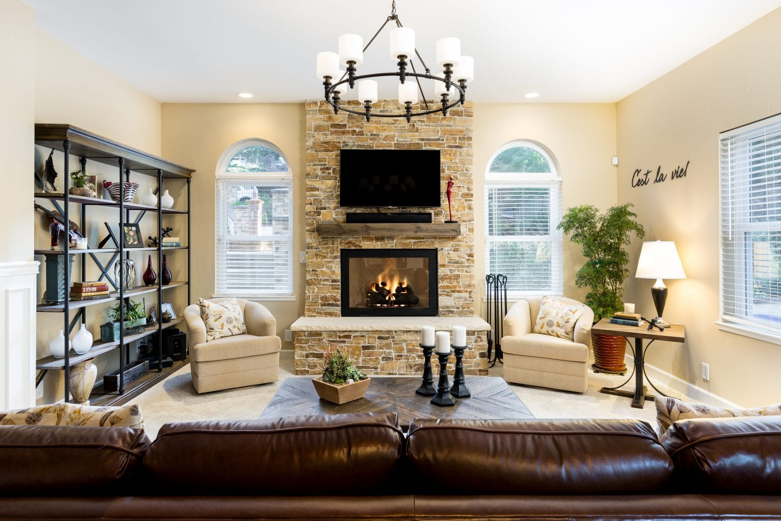 Living space with TV mounted to stone fireplace