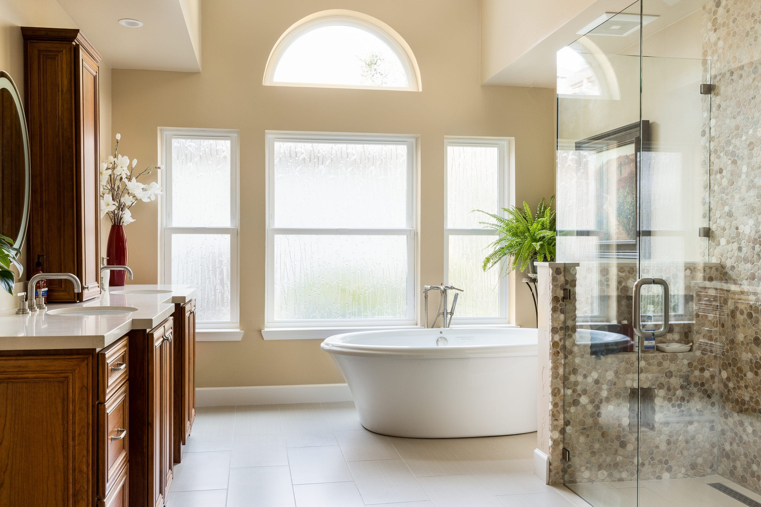 Stand alone tub in front of windows