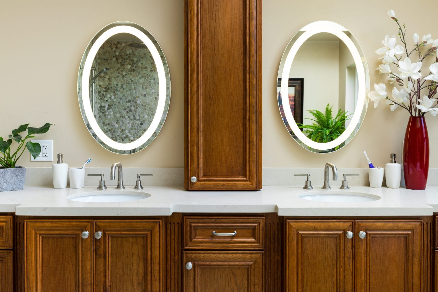 Bathroom with two oval mirrors with built-in lighting